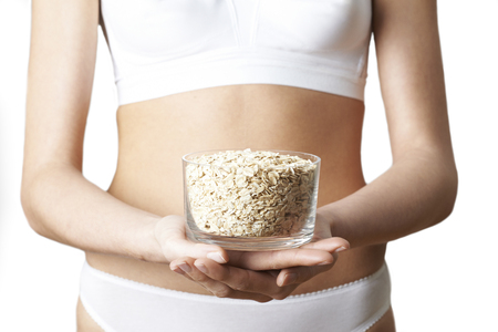 Close Up Of Woman In Underwear Holding Dish Of Oats Stock fotó