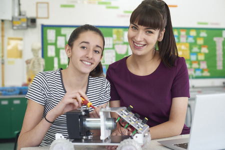 Portrait Of Teacher With Female Pupil Studying Robotics In Science Lesson Stock fotó