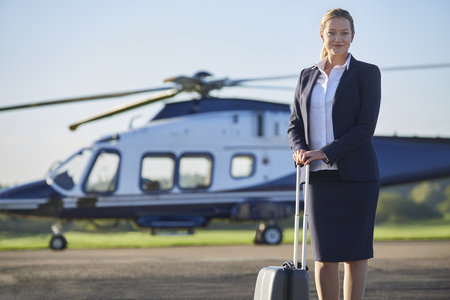 Portrait Of Businesswoman Standing In Front Of Helicopter  Stock fotó