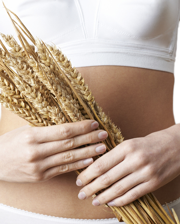 Close Up Of Woman Wearing Underwear Holding Bundle Of Wheat