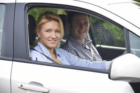 Portrait Of Young Couple Looking Out Of Car Window Stock fotó