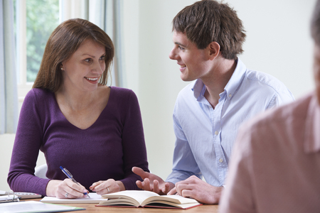 Mature Woman With Tutor In Adult Education Class