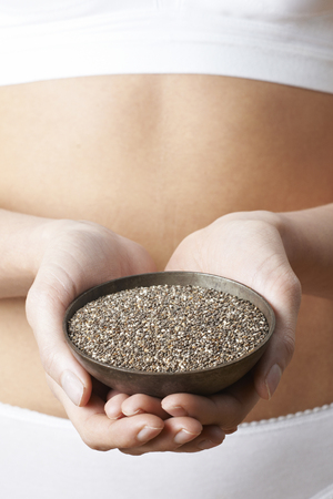 Close Up Of Woman Wearing Underwear Holding Bowl Of Chia Seeds