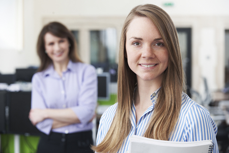 Portrait Of Young Businesswoman With Mentor In Office Stock fotó