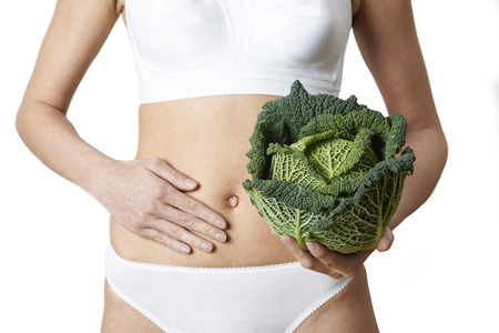 Close Up Of Woman In Underwear Holding Cabbage And Touching Stomach Stock fotó