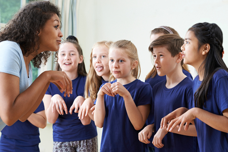Group Of Children With Teacher Enjoying Drama Class Together Stockfoto