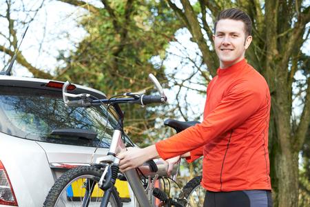 Cyclist Taking Mountain Bike From Rack On Car Stock fotó