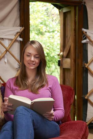 Woman Enjoying Luxury Camping Holiday In Yurt