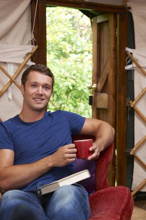 Portrait Of Man Enjoying Luxury Camping Holiday In Yurt Stock fotó