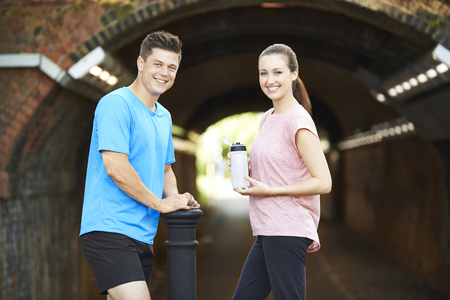 Portrait Of Couple Taking A Break During Exercise In Urban Environment Stock fotó
