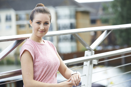 Portrait Of Woman Using Activity Tracker Whilst Exercising In City Stock fotó