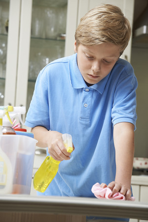 Unhappy Boy Helping to Clean House