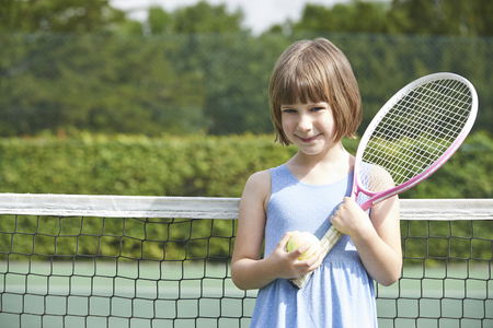 Portrait Of Young Girl Playing Tennis