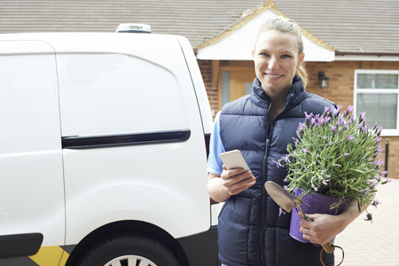 Portrait Of Woman Running Mobile Gardening Business Using Mobile Phone