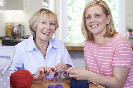 Portrait Of Senior And Mature Female Friends Knitting At Home Together Stock fotó