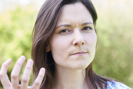 Outdoor Portrait Of Frustrated Young Woman Stock Photo