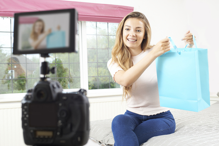 Female Vlogger Recording Broadcast In Bedroom