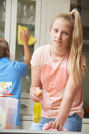 Unhappy Children Helping to Clean House Stock Photo