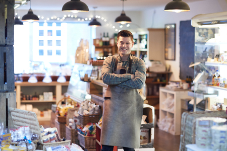 Portrait Of Smiling Male Owner Of Delicatessen Shop Wearing Apron