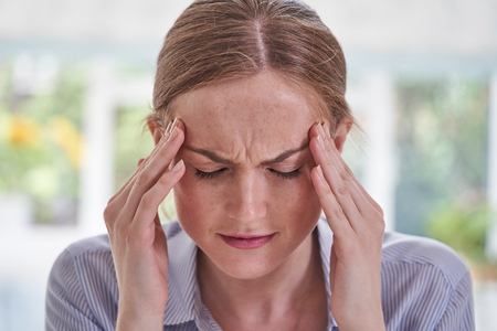 Close Up Shot Of Young Woman Suffering With Headache Stockfoto - 122891866
