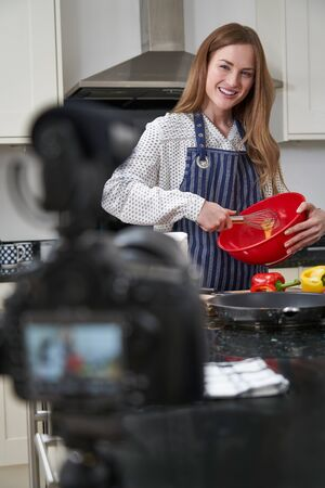 Female Vlogger Making Social Media Video About Cooking For The Internet