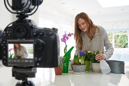 Female Vlogger Making Social Media Video About Houseplant Care For The Internet