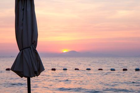 amat: Beach umbrella at sunset in North Pattaya beach
