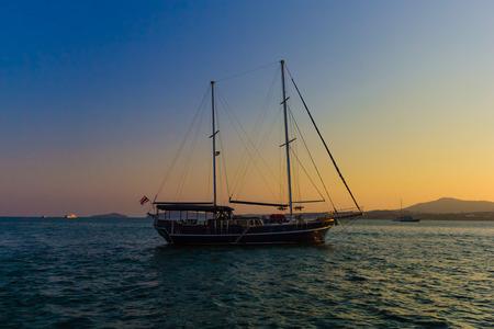 ocean and sea: Old fasioned sail boat   at sunset near Phuket