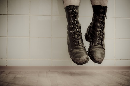 Old military boots captured during jump. photo