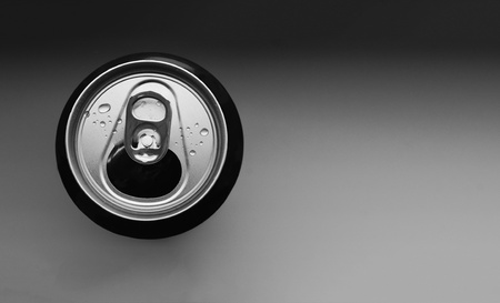 Refreshing drink in a can with water droplets. photo