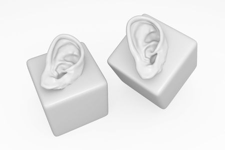 Isolated 3d human ear model on cube, over white photo