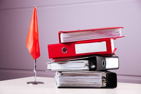 Office table folders papers reports working place flag