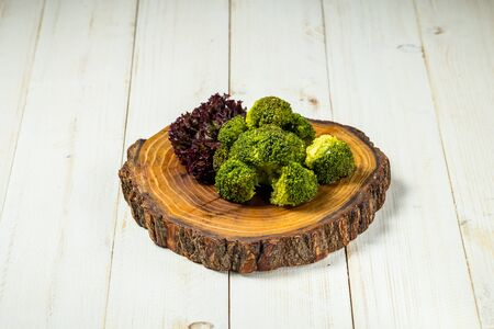 Healthy snack boiled broccoli vegetable on a wooden board, horizontal