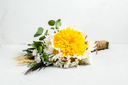 Beautiful fresh light bouquet of flowers on a white background, horizontal 免版税图像
