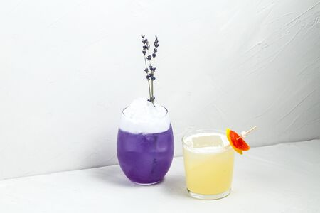 Beautiful delicious colourful decorated alcohol cocktail set in different glasses on the white background, horizontal Stok Fotoğraf