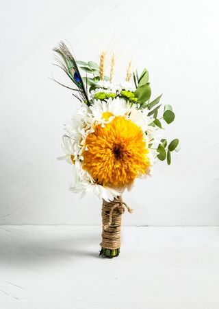 Beautiful fresh light bouquet of flowers on a white background, vertical 免版税图像