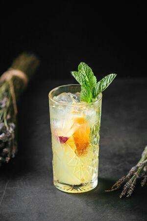 Refreshing cool fruit lemonade cocktail with mint, vertical Stok Fotoğraf