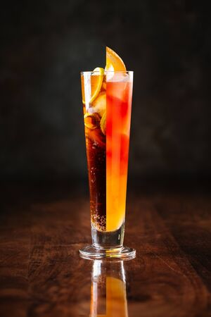 Side view on two types of cocktails in highball glass, vertical
