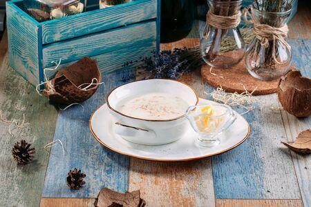 Healthy breakfast oatmeal porridge with butter, horizontal