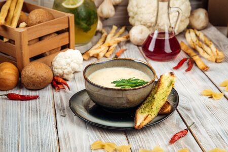 Gourmet potato soup with cream and smoked horsemeat, horizontal