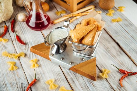 Appetizer breaded fried tender mozzarella cheese with tartar sauce, horizontal