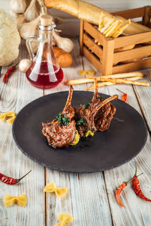 Delicious rack of lamb with hummus sauce, vertical