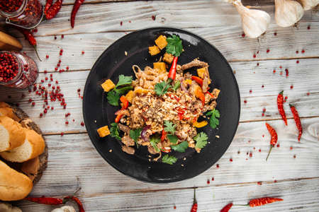 Top view on asian rice pad thai noodles with beef vegetables and tofu, horizontal