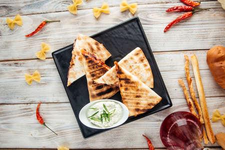 Top view on quesadilla with tomato tortilla fajito chicken and mozzarella cheese, horizontal