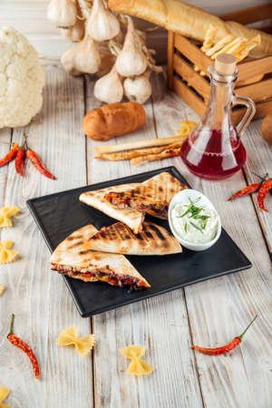 Quesadilla with tomato tortilla fajito chicken and mozzarella cheese, vertical