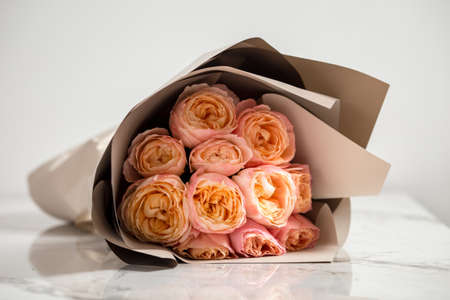 Beautiful tender pink roses bouquet on the white background, horizontal