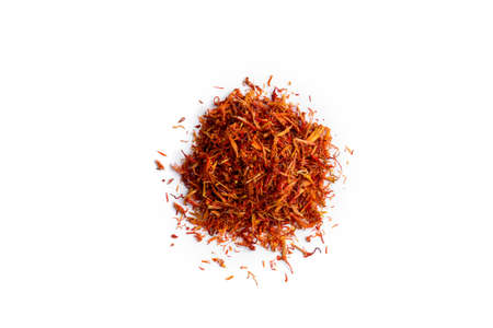Top view on isolated heap of dried spice saffron