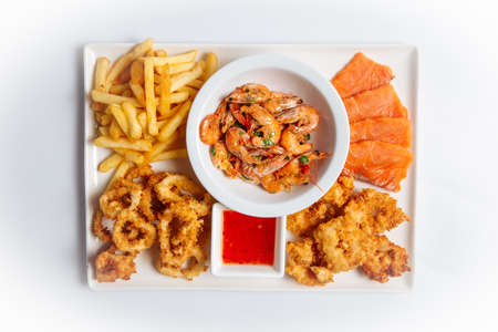 Top view on on isolated beer appetizer seafood snack platter on the white background