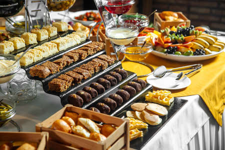 Restaurant lunch catering buffet with different sweets Stock Photo