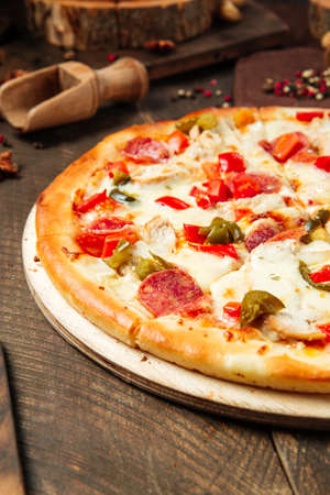 Closeup on spicy mexicano pizza with jalapenos on the wooden table Фото со стока